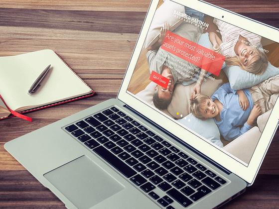 Baringer-Hartman-Insurance-Group_Mobile_Layout-Homepage_notebook-mockup01